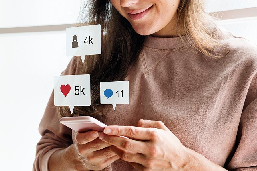 woman-using-smartphone-social-media-conecpt